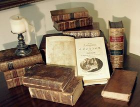 780px grose antique books with candle article