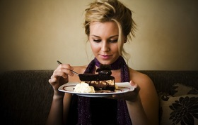 Woman eating cake article
