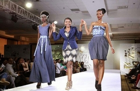 1444857862colombe ituze ndutiye  centre  walks with models cladding her pieces at the kigali fashion week in november  2013 article