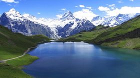 Live switzerland schreckhorn and wetterhorn alps mountain view from bachalpsee lake article