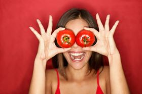 Woman with tomatoes article