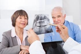 Photodune 7732114 dentist explaining xray to senior couple xs article
