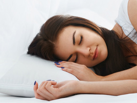 Woman sleeping peaceful istock pt article