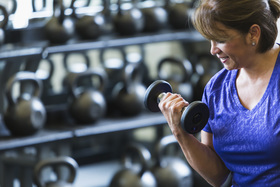 Mature woman lifting dumbbell istock pt article