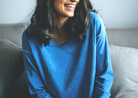 Tfd young woman blue sweater laughing article