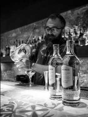 Mezcal amores mexico 2 b w bartender pouring article