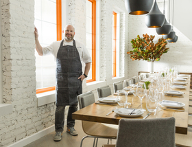 Chef dan kluger standing in pdr loring place lesley unruh for one kings lane article