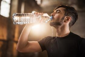 Trash man drinks water article