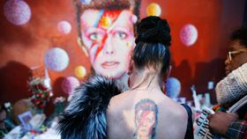 Woman mourning bowies death article