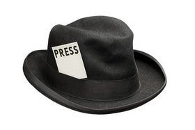 Hat with press card article