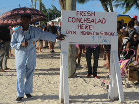 Conch fest man with umbrella article