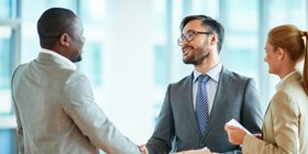 Handshake job interview happy article