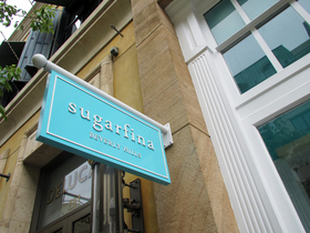 Sugarfina sign article