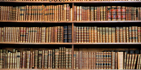 Stacks of books in library article