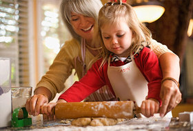 Getty rf photo of woman baking with granddaughter article