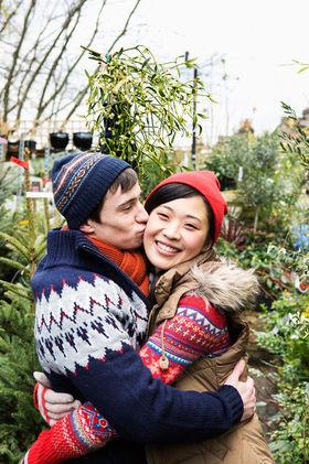 9 couple kissing among christmas trees h724 article