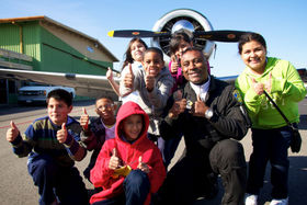 Robin with kids and plane article