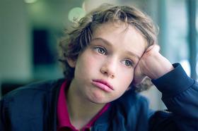 Sad kid in school 2 article