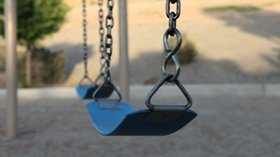 Stock footage empty swing set article