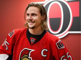 Erik karlsson is all smiles as he waits to talk to the media1 article