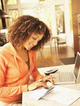635509684442892340 woman paying bills article