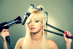 Woman fixing hair tools article