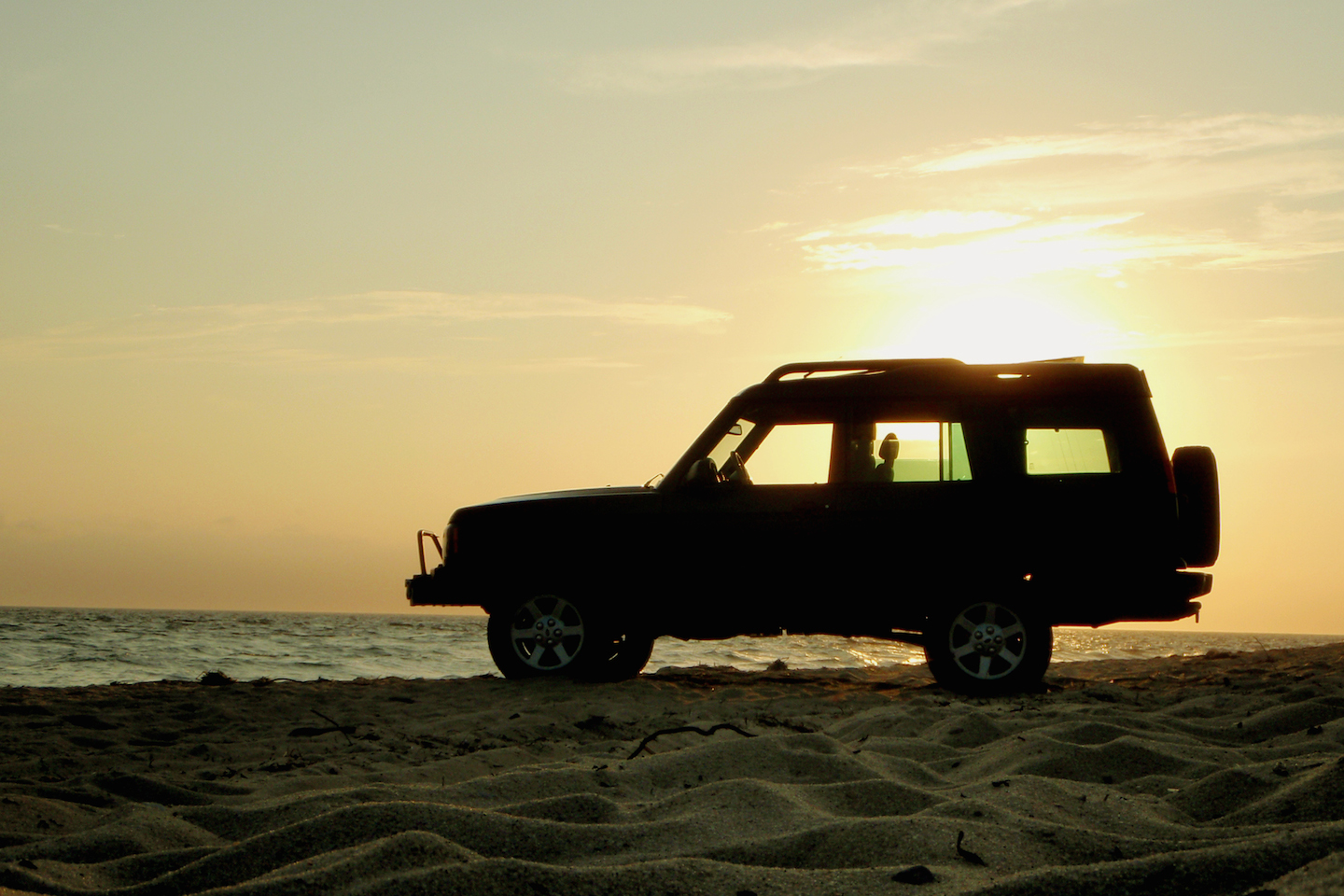SUV sitting in the sand