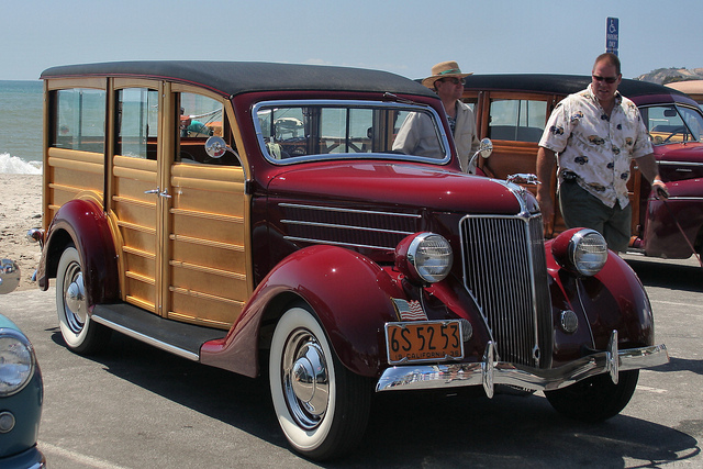 Red 1936 Ford Deluxe Wagon by the beach