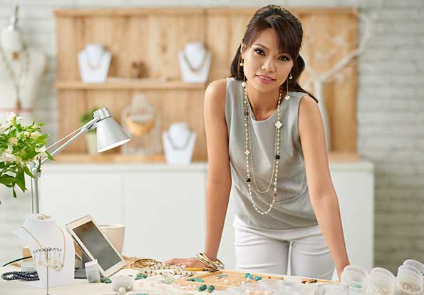 Woman standing in front of desk in jewelry shop