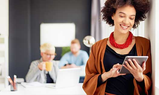 Woman on tablet in office space