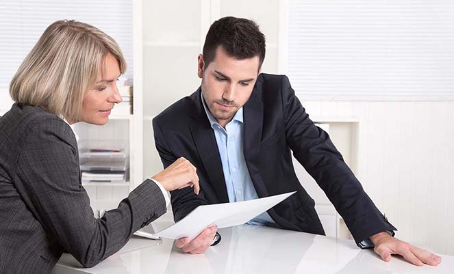 Two businesspeople looking at documents