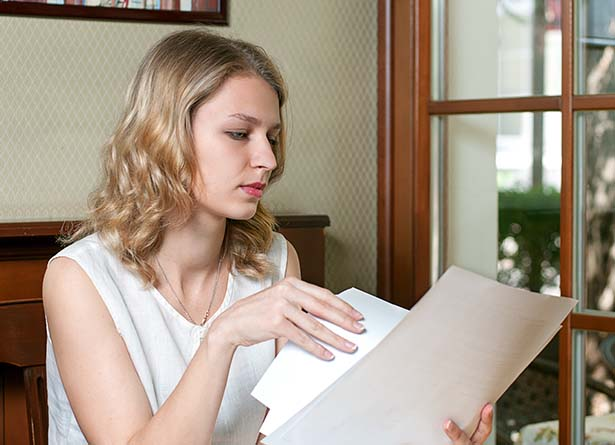 Woman flipping through documents
