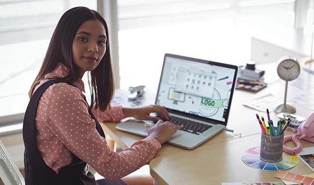Woman at computer designing logos