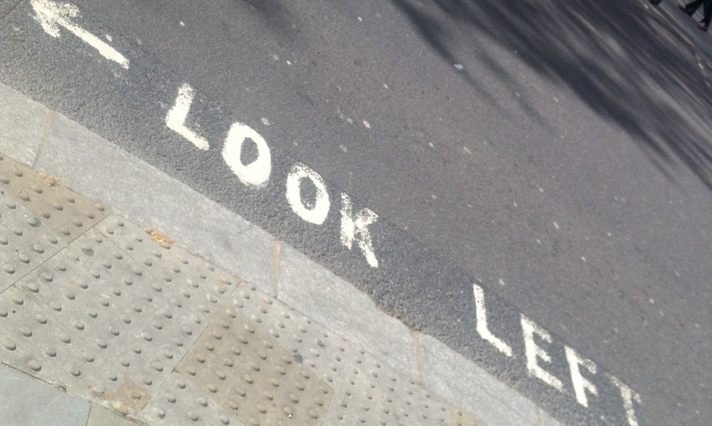 "A ""look left"" sign in England."
