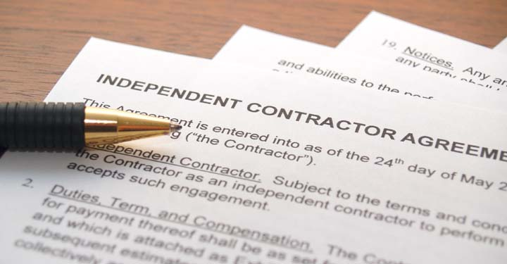 Pen sitting on independent contractor agreement