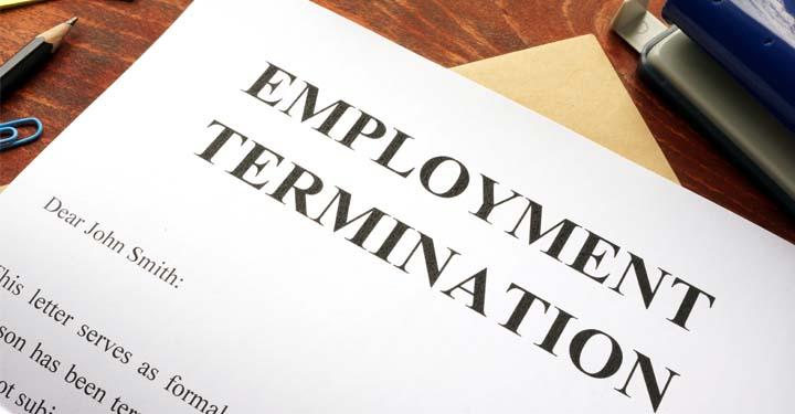 Employment termination letter on wooden desk