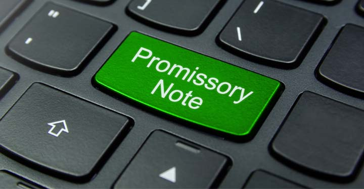 """Laptop keyboard with a key labeled """"Promissory Note"""""""