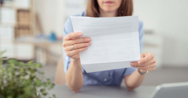 Woman holding and reading a document