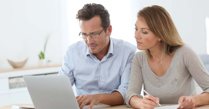 Woman and man looking at a laptop together