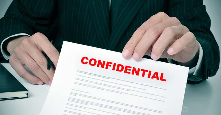 Hands presenting a confidential document