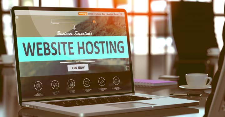 """Open laptop with the words """"website hosting"""" on the screen"""
