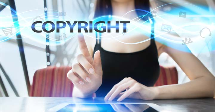 """Woman pointing to text that reads """"copyright"""""""