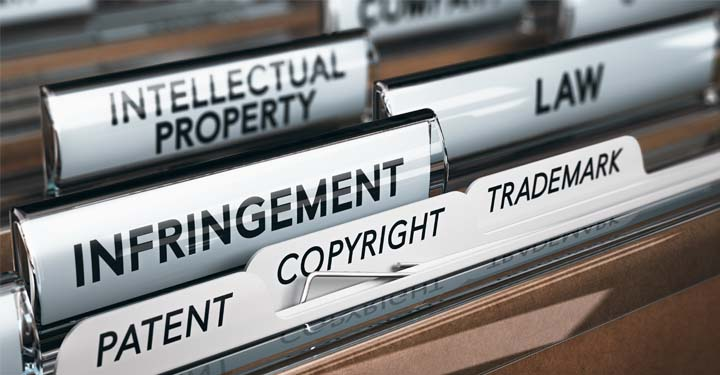 """File tabs containing words """"intellectual property,"""" """"infringement,"""" """"patent,"""" """"copyright,"""" """"trademark,"""" and """"law"""""""