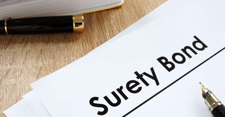 "Piece of paper with the words ""Surety Bond"" printed on it"