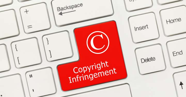 """Red key on computer keyboard which says """"copyright infringement"""""""