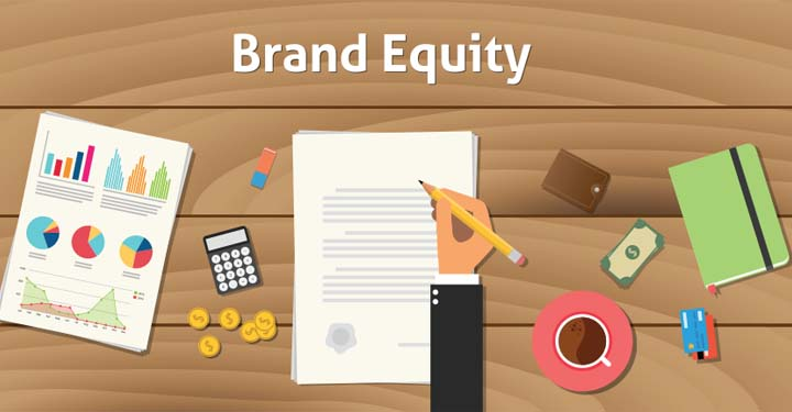 """Illustrated hand holding a pencil and signing a document under the words """"Brand Equity"""".  Surrounding the document on the table are a calculator, money, charts, a notebook, and other branding tools."""