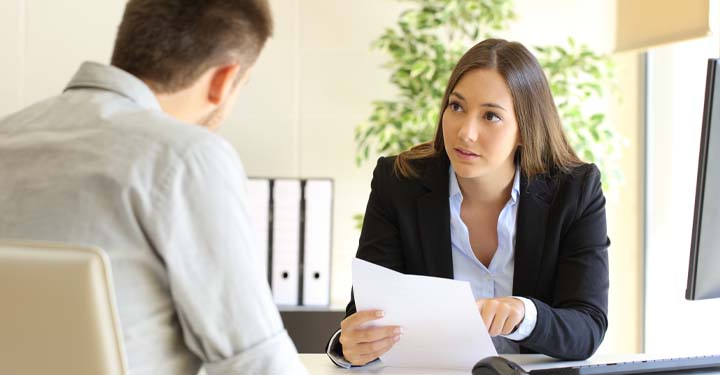 Businesswoman reviewing paperwork with a coworker