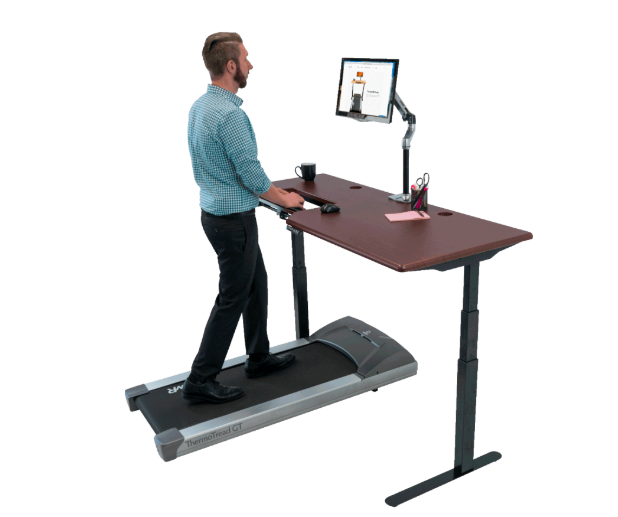 man working on computer at a treadmill desk