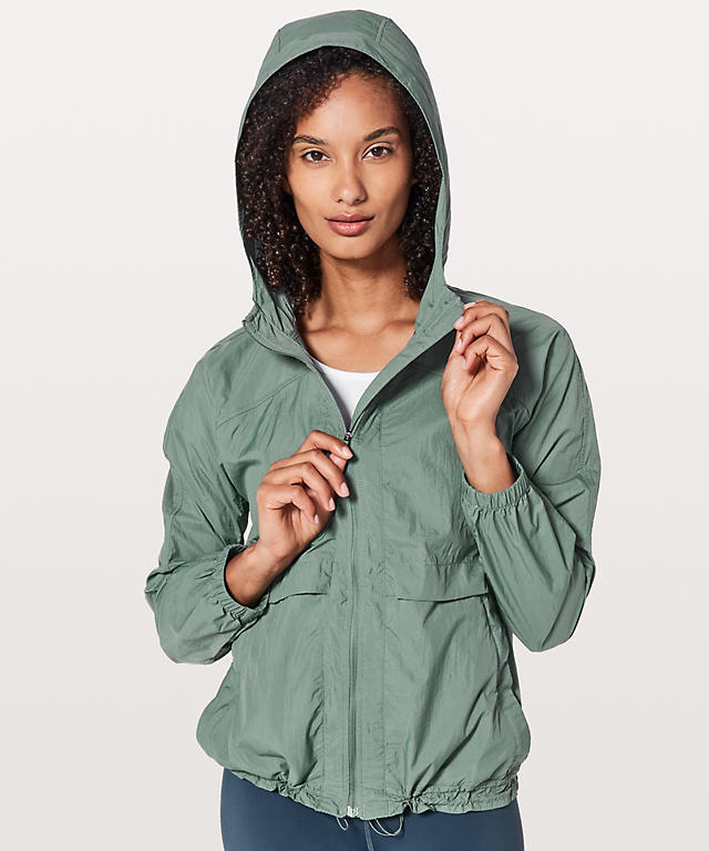 woman wearing packable hood lite jacket - fall workout clothes