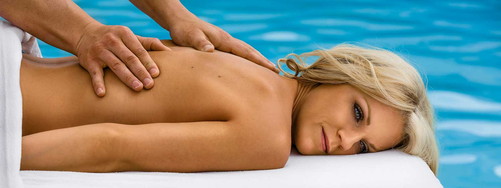 woman getting a massage pool-side at the Fairmont Hot Springs spa resort